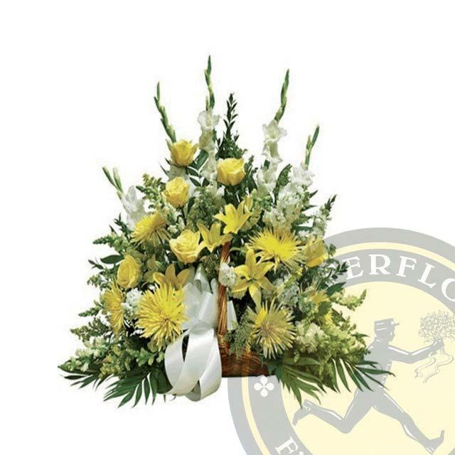 Cesto funebre con rose e fiori gialli e bianchi