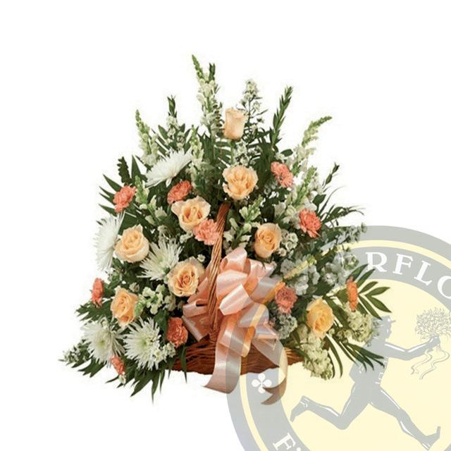 Cesto funebre con fiori dai toni arancio